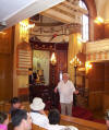 Interior view of Sandys Row with the late Jimmy Wilder showing a group of visitors his lovely synagogue
